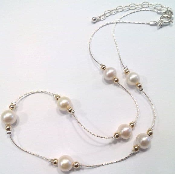 'Tin Cup' style pearls on a silver chain with gold beads.