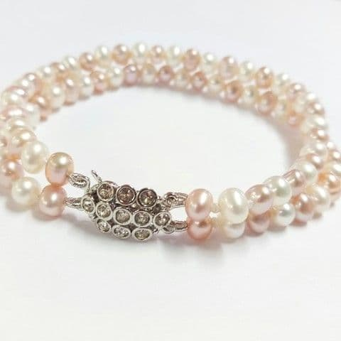 2-row white and peach-pink pearl bracelet