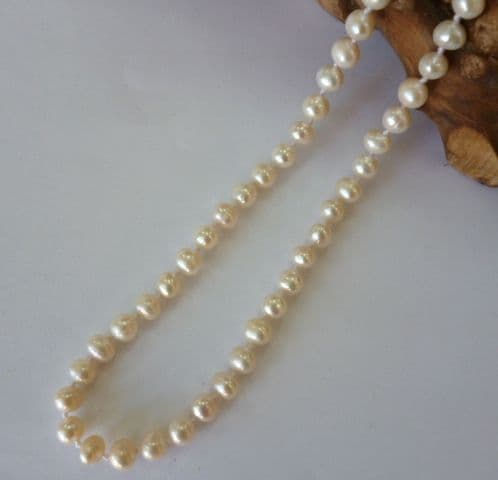 Delicate Necklace of Petite White Pearls