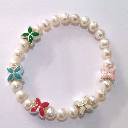 enamel flowers on a pearl bracelet