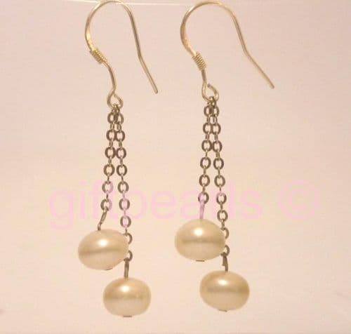 Twin pearl drops on silver chain.
