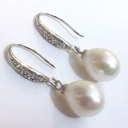 White tear-drop pearl and silver ear-rings with CZ crystals.